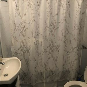 Marble shower curtain with rose gold hooks